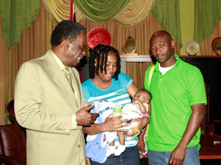 THA Chief Secretary Orville London was all smiles when the Frank family, Aldensia, Darrel (right), and baby Darius paid a courtesy call to the Office of the Chief Secretary, Administrative Complex, Calder Hall on Monday (March 23, 2015)