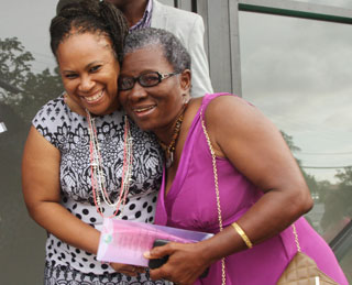Secretary of Community Development and Culture Councillor Dr Denise Tsoiafatt-Angus (left) and villager Vida Romeo hug each other at the opening of the Bethesda Multipurpose Facility on Sunday. Photos courtesy THA.