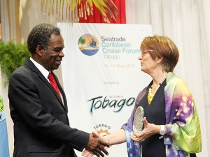 THA Chief Secretary Orville London shakes hands with Global Events Director and Managing Director of Seatrade Middle East, Vanessa Stephens, at the forum.