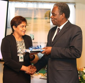 THA Chief Secretary Orville London is presented with reports on climate change adaptation and coastal zone management in Tobago by Dr Rahanna Juman on behalf of the IMA. Photo courtesy THA.