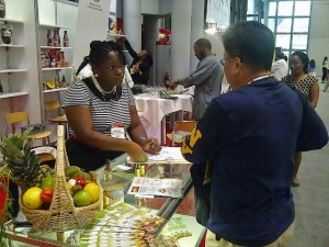 Mrs. Darilyn Smart, President of Tobago Agro Processors Association engages a potential client at the Sumer Fancy Food Show.