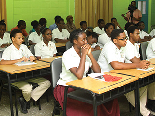 Students of Bishop's High School, Tobago listen attentively to THA Chief Secretary Orville London discussing self governance for Tobago. Photo courtesy THA.