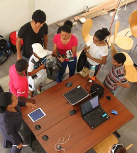 Students get an up close view of the underwater camera during the interactive workshop.