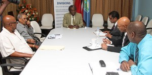 THA Chief Secretary, centre, chairs the meeting between officials of the THA and the PATT.