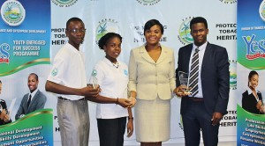 Outstanding Leadership Awardees: From left to right: Agents of Change-Arthur Goddard and Lloyen Scotland, Assistant Programme Director of the Youth Energised for Success Programme, Ms Shamfa Cudjoe and Dexter Wilson Jr. from the Summer Internship Programme. Absent from the photo is Kofi Daniel, who was also an award recipient.