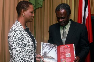 Chief Secretary Orville London and Minister of Tobago Affairs show off the latest edition of Capital of Paradise 11 during the Minister's courtesy call on Monday. Photos courtesy THA