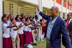 Students at Bishops High School wave in excitement during the the Honourable Dr. Keith Rowley's visit to their school.