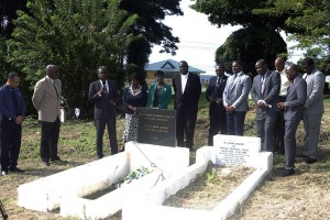 THA Chief Secretary Orville London pays tribute to former president and prime minister of Trinidad and Tobago, Arthur Napoleon Raymond Robinson, while Presiding Officer Kelvin Charles, second from left, Secretary of the Division of Health and Social Services Claudia Groome-Duke, fourth from left, and other Tobago House of Assembly representatives look on.