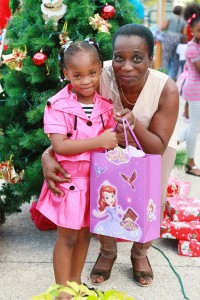 Director of Finance and Enterprise Development, Mrs. Esther Pilgrim-Soanes with an adorable little lady at the Division's Christmas Party which was held on the 29th November, 2015 at the Victor E. Bruce Financial Complex.
